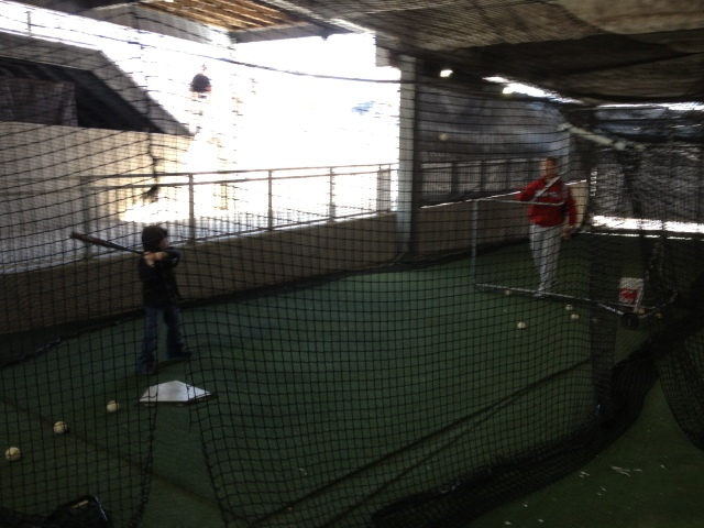 A young fan taking swings in the Senators' batting cages