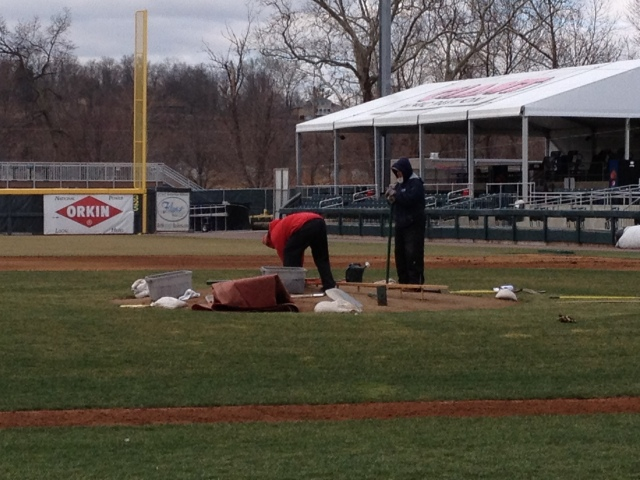 The grounds crew working on the pitcher's mound